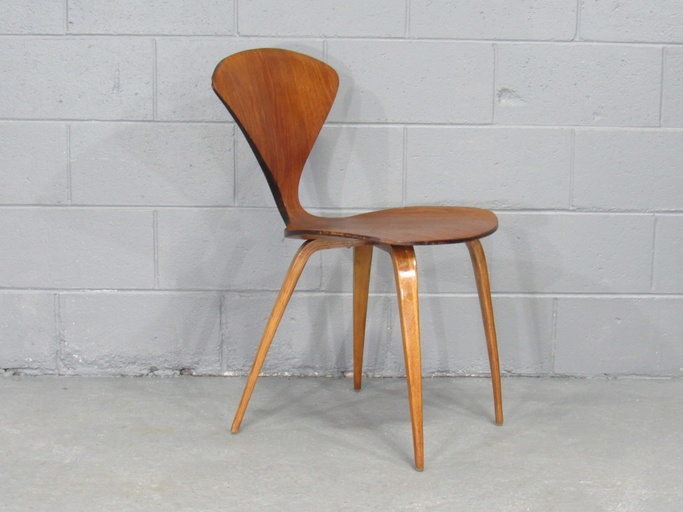 Early Mid-Century Modern Side Chair by Norman Cherner for Plycraft in Walnut. Circa 1950s.
