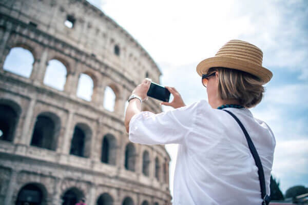 Woman Taking A Picture Of The Coliseum In Rome