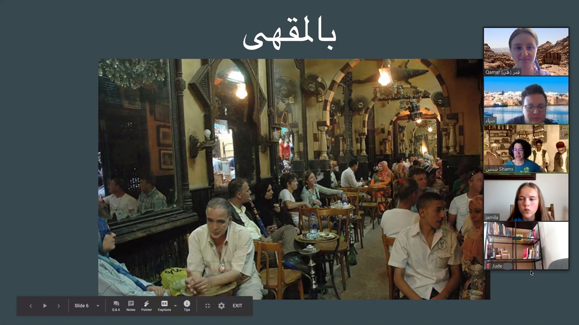 People sitting at a huge café in Egypt, smoking shisha, drinking coffee, and chatting.