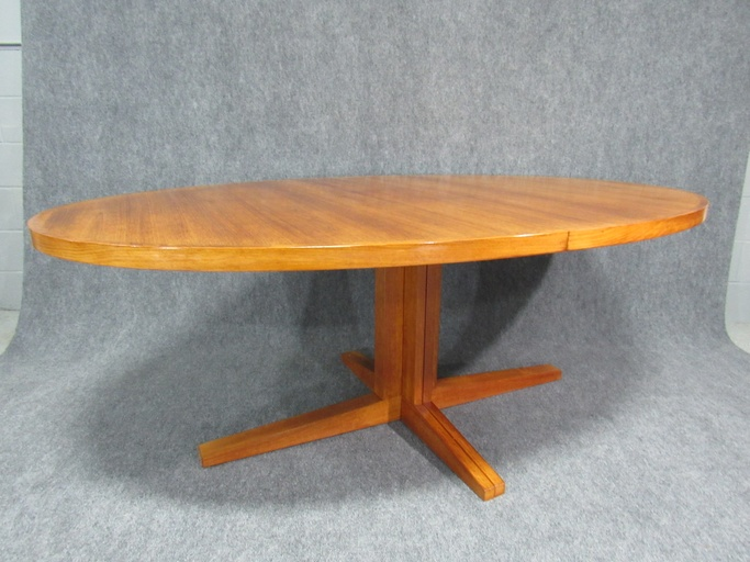 Oval teak extension dining table.  Circa 1960s. - DO NOT POST
