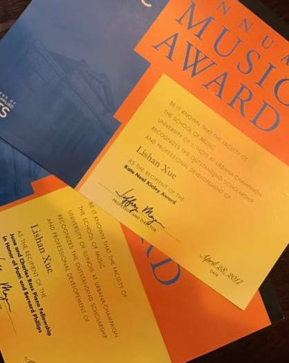 Two awards certificates