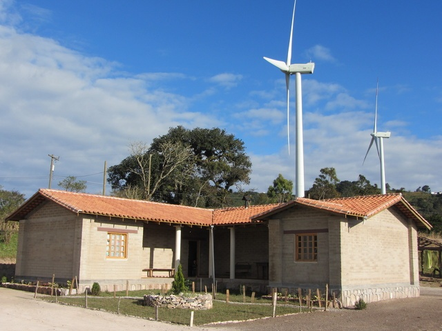 Energy from the 51 wind turbines in this project help power rural schools and homes, like this one located in the hills of Cerro de Hula and Izopo