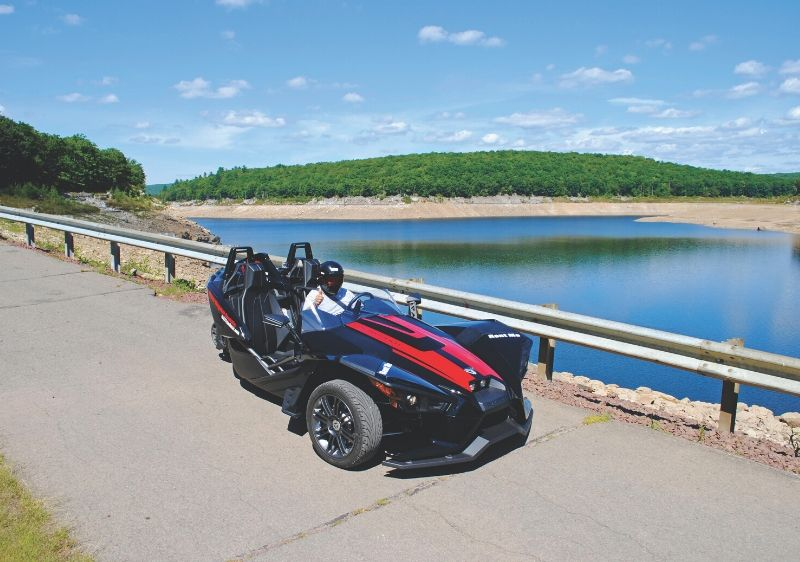 guest-in-a-parked-Polaris-Slingshot-by-to-a-river