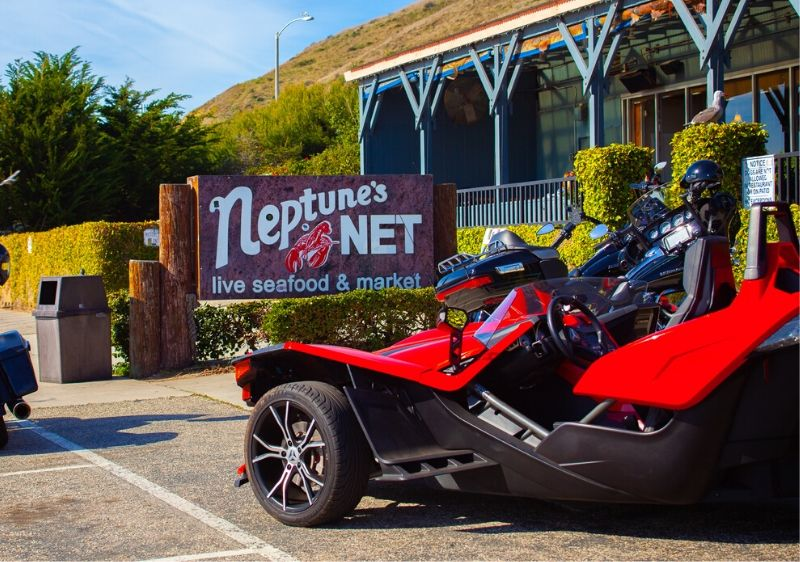Polaris-Slingshot-parked-out-front-Neptunes-Net-restaurant
