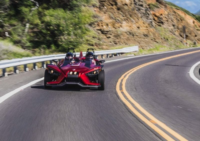 guests driving a Polaris Slingshot