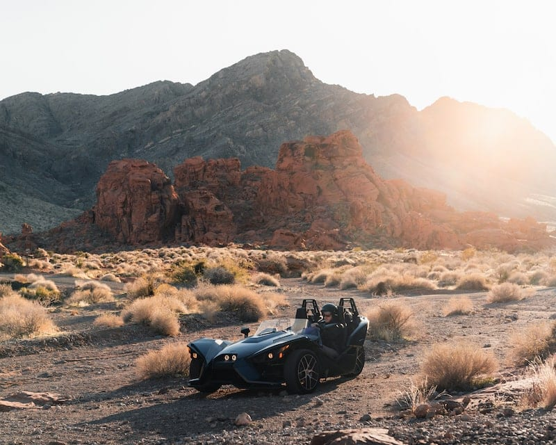 Desert sun shining down on a Polaris Slingshot