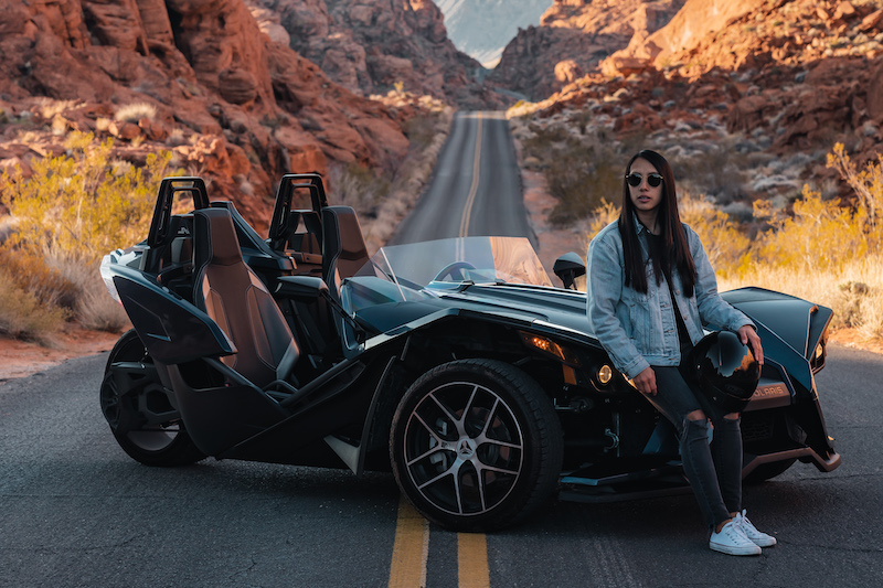 Slingshot-and-its-driver-posing-in-the-Valley-of-Fire