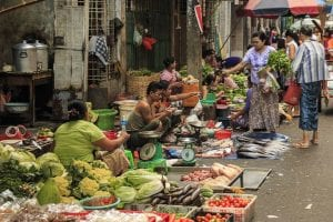 Yangon Downtown streets are crowded with people selling produce