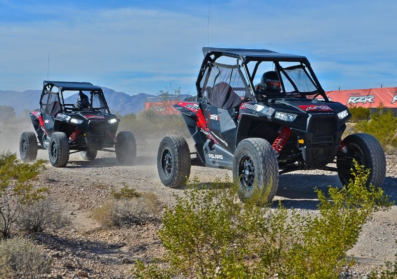 guests-driving-Polaris-RZRs-on-rocky-terrain