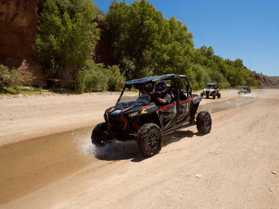 off-road vehicles driving through stream