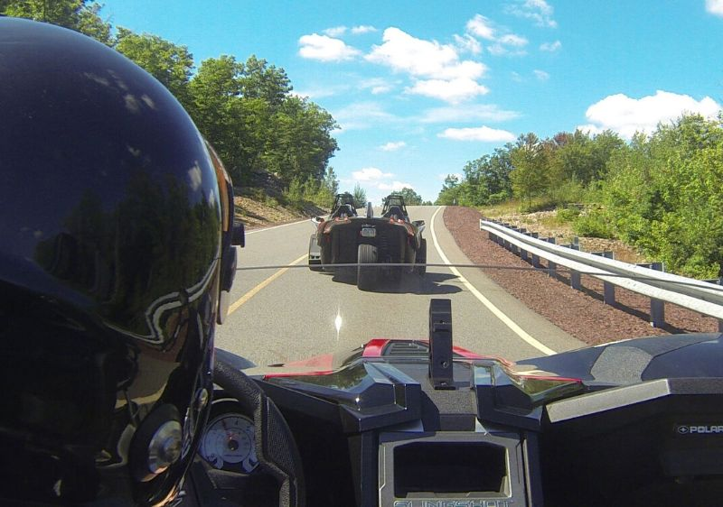 rear-view-of-guest-driving-Polaris-Slingshots-around-a-curvy-road