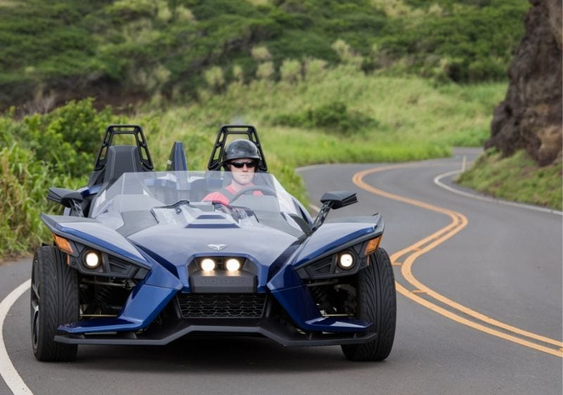 guest-driving-a-Polaris-Slingshot-on-a-curvy-road