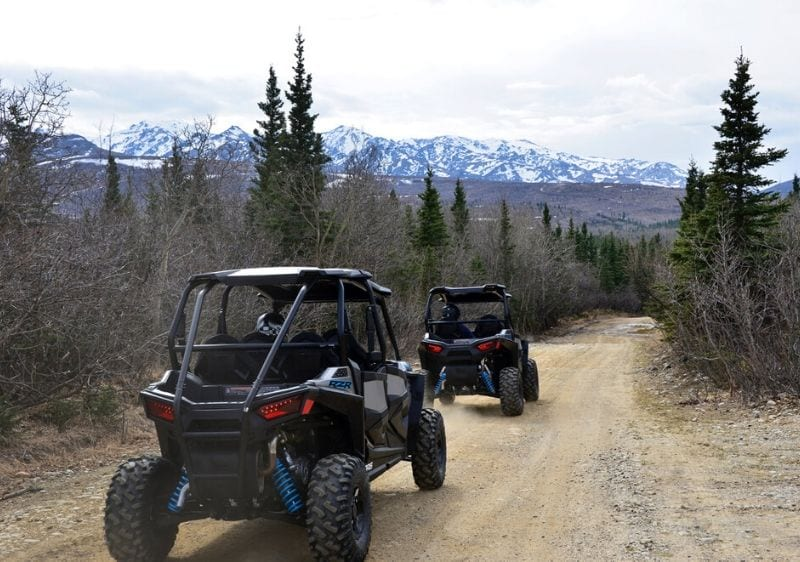 off-road vehicles on dirt trail