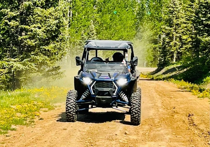 off-road vehicle driving on dirt trail1