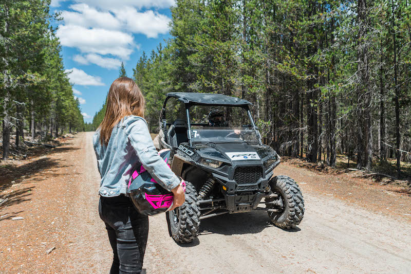Girl-walking-towards-RZR