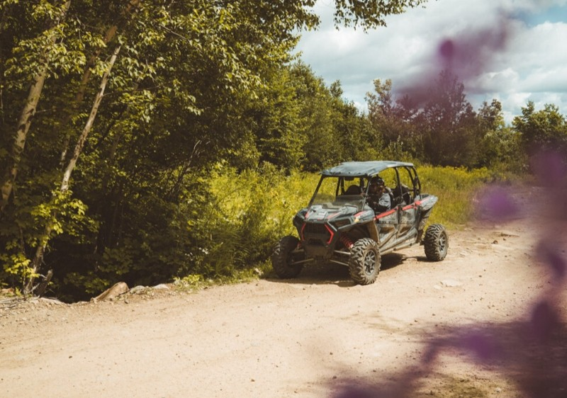 Polaris-RZR-driving-on-a-dirt-path