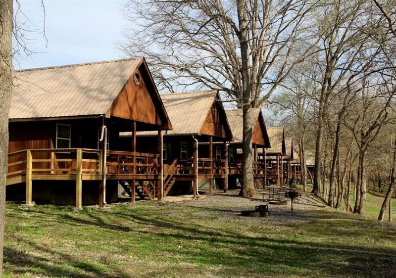 row of wood cabins in Mark Twain National Forest