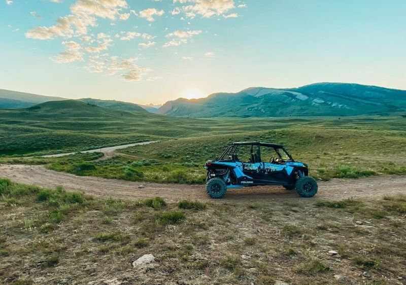 off-road vehicle driving through mountain scenery