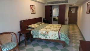 An old-styled double bed room in Mei Ho House. It's the taste of Hong Kong.