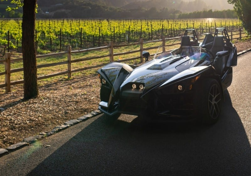 Polaris Slingshot parked along a winery in Missouri wine country