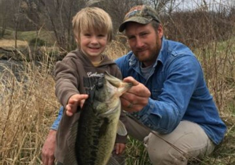 father-and-son-holding-a-bass