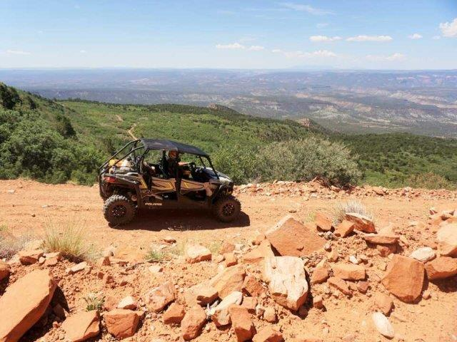 off-road vehicle parked at a scenic overlook