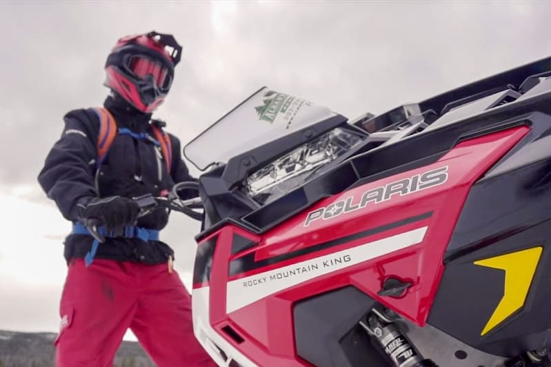Rider and red Polaris snowmobile
