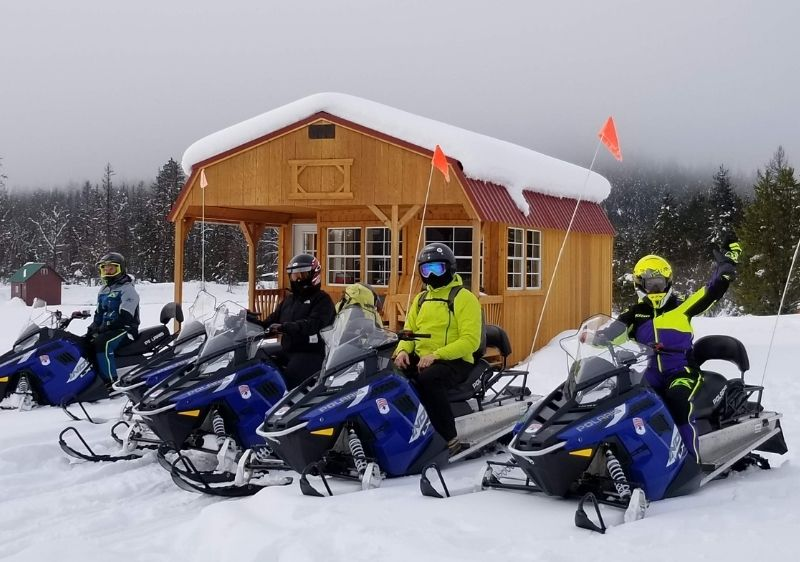 Snowmobiling-tour-group-parked-in-front-of-Priest-River-warming-cabin-PRV