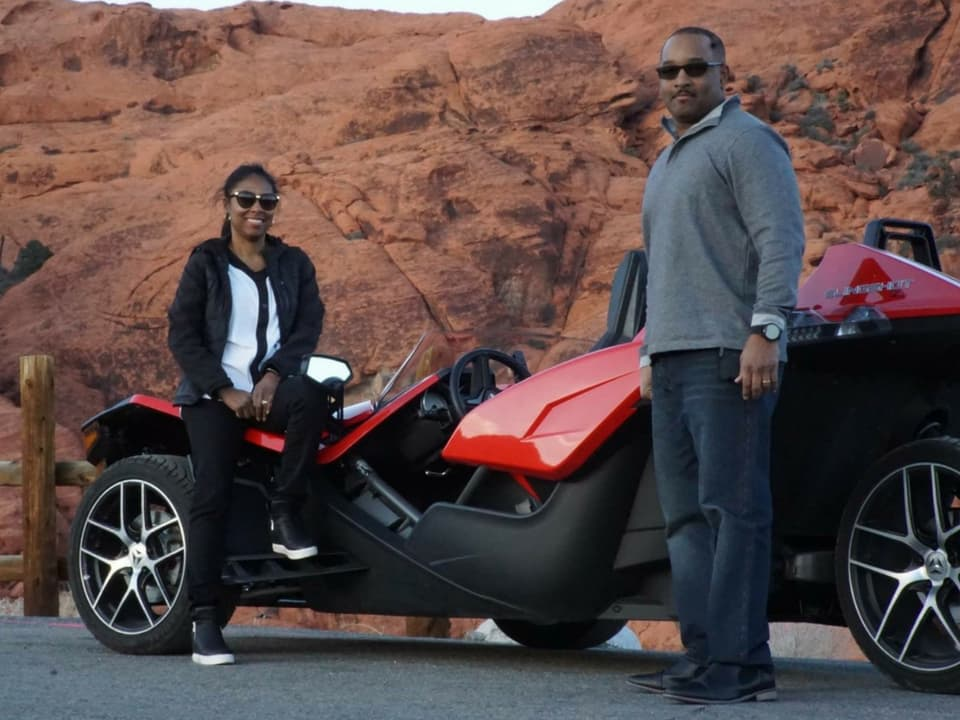 guests standing by Polaris Slingshot