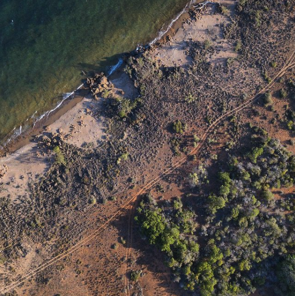 An aerial view of a coastal track