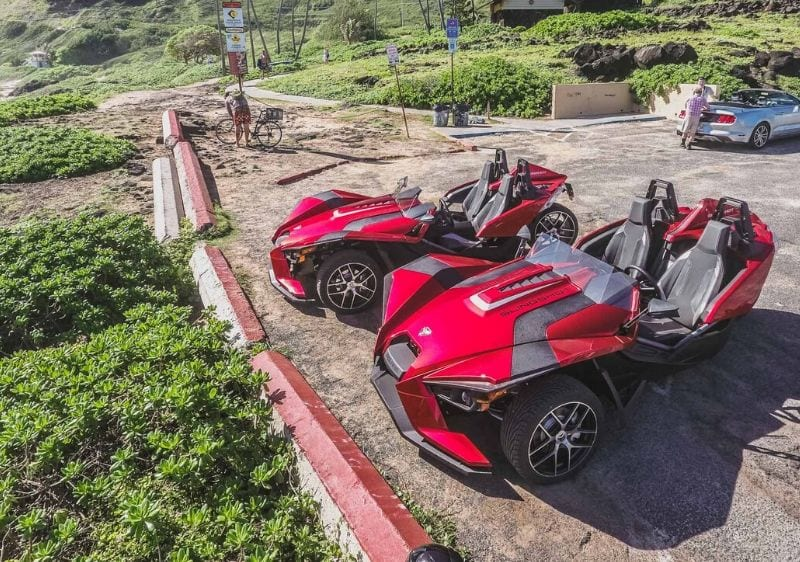 Polaris Slingshots parked at a scenic pullover