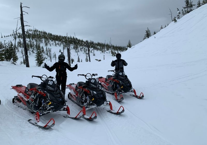 guests-giving-a-thumbs-up-by-Polaris-Snowmobiles
