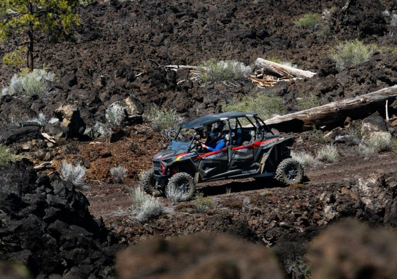 off-road vehicle driving through lava remains