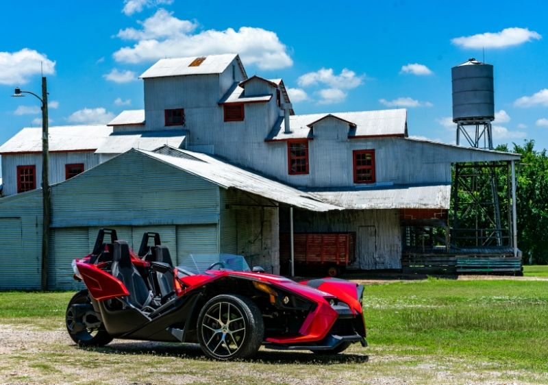 Polaris-Slingshot-parked-in-front-of-an-old-building-outside-of-Houston