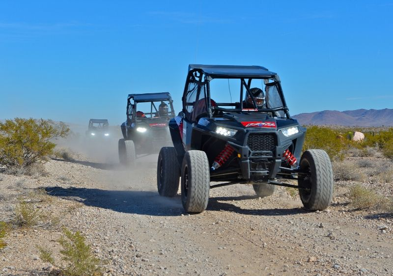 guests-driving-Polaris-RZRs-trhough-the-desert