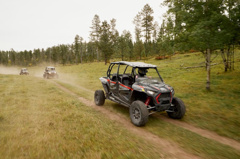rzrs-driving-in-woods-at-Spearfish-Canyon Resort