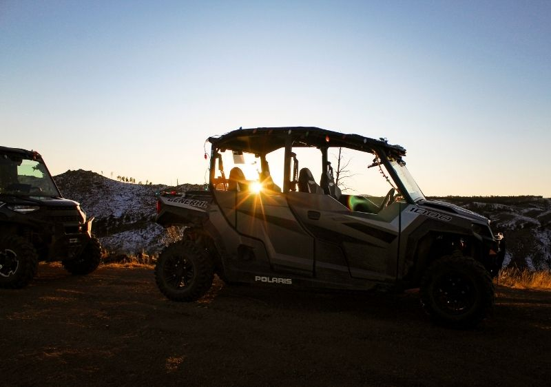 off-road vehicles in the sunset