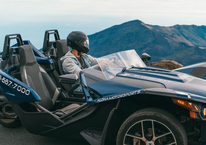 guest overlooking a scenic view from a Polaris Slingshot