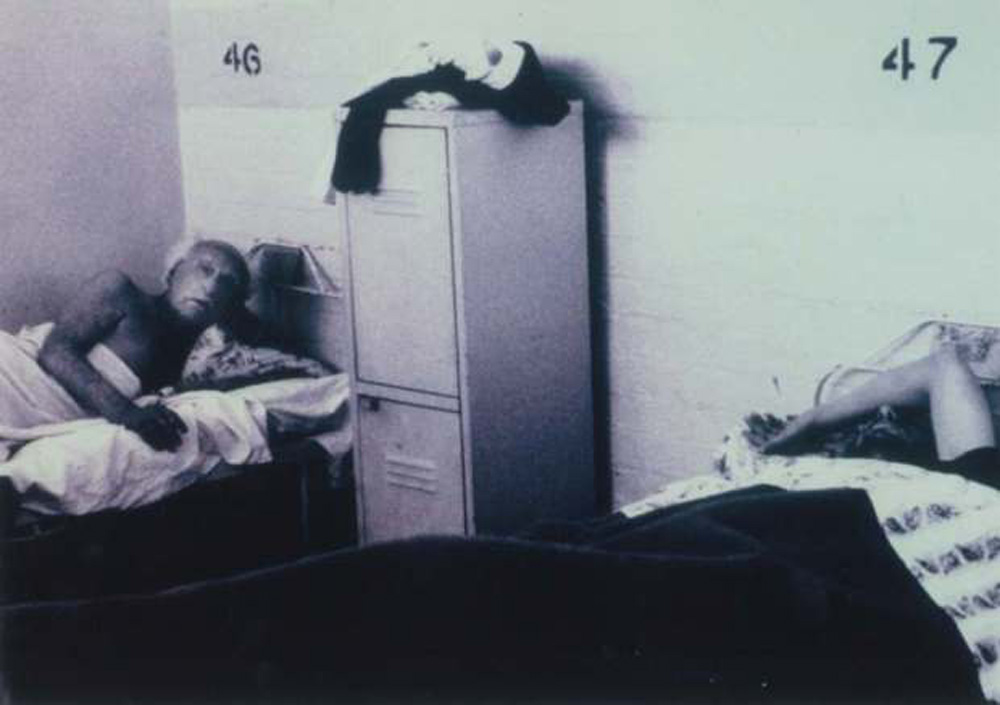 A photo of a room in the Wintringham Hostel. The room has two beds.