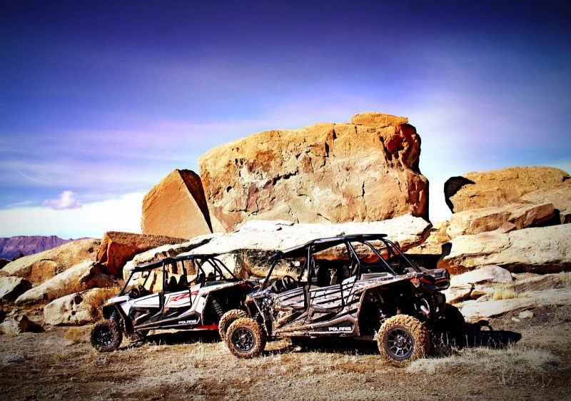 Polaris-RZRs-parked-in-front-of-large-rocks