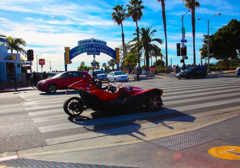 guest-driving-a-Polaris-Slingshot-around-the-Santa-Monica-pier