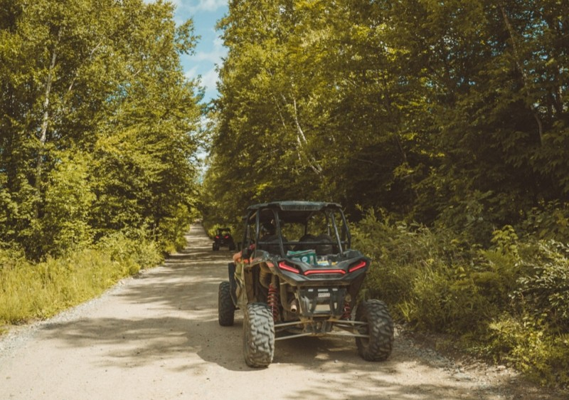 guests-driving-Polaris-RZRs-off-road-down-a-dirt-path1