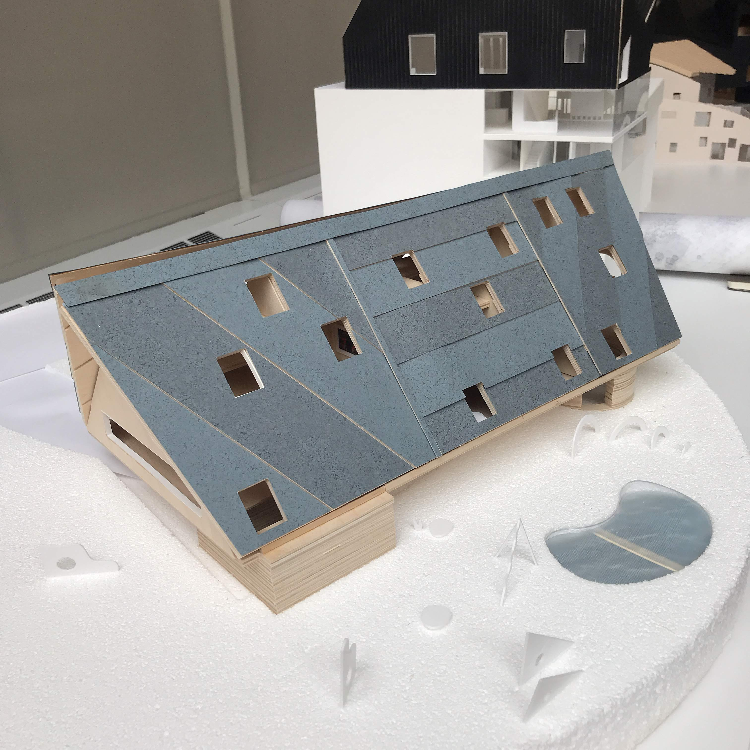 Assembled, with paper coating on the facade.