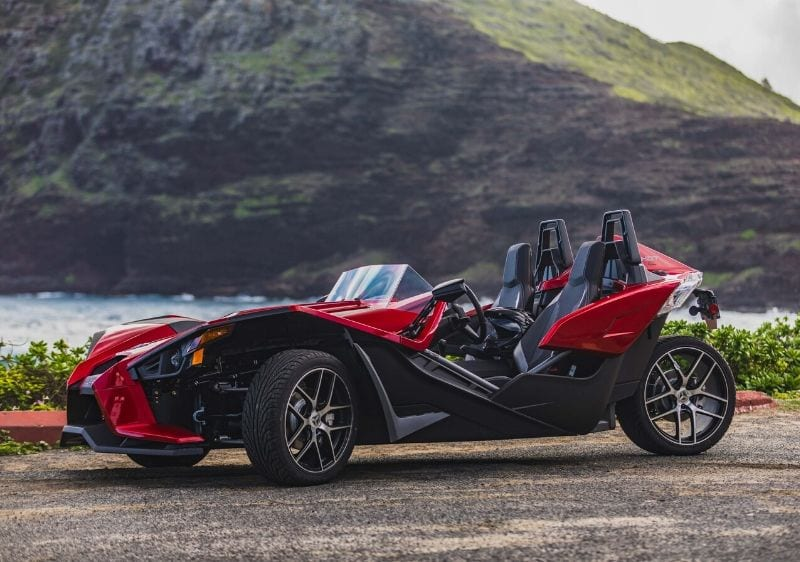 Polaris Slingshots parked in front of a scenic mountain range
