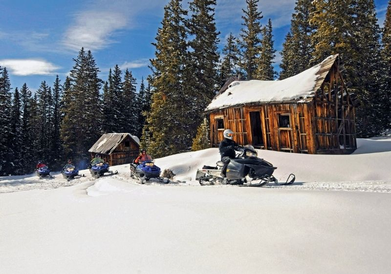 snowmobile tour through historic ghost town