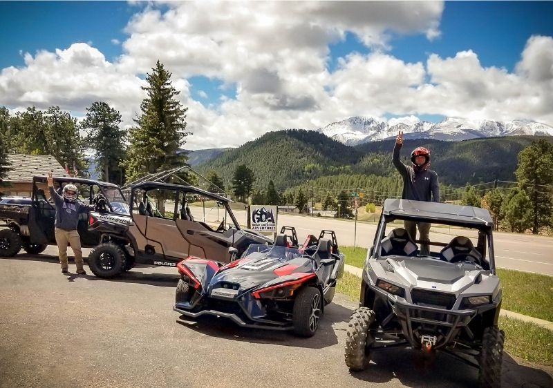 guests standing by off-road and on-road vehicles