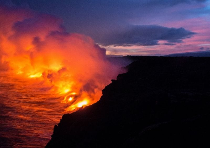 Volcano lava pouring into the ocean