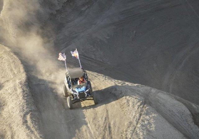 off-road vehicle on a large dirt mound