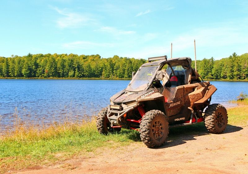 Polaris-RZR-parked-along-a-body-of-water