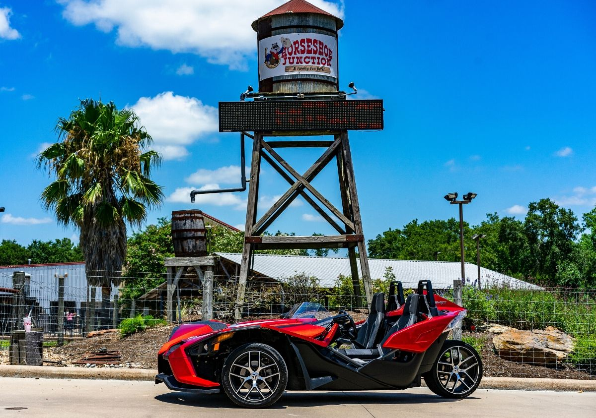Polaris-Slingshot-parked-in-front-of-an-old-water-tower1